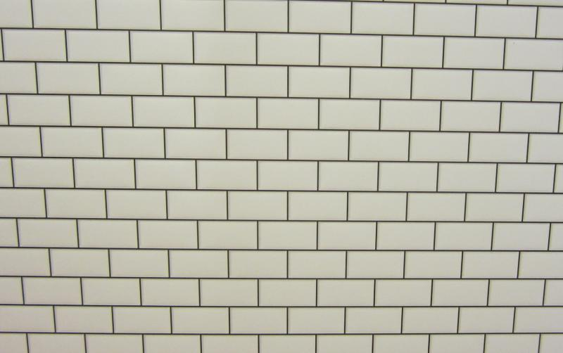Embossed white metro tiling with dark grout