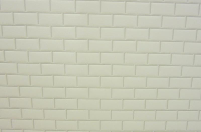 Embossed white metro tiling
