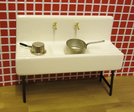 Porcelain sink with gold taps